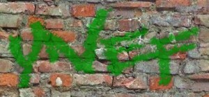 ynef graffity on brick wall text effect logo
